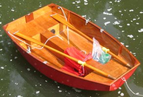 Pram dinghy on the water